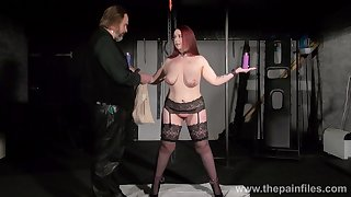 Big woman in stockings and garters Kitty is punished with clothes pins