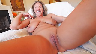 Solo closeup video of powered adult Meegan playing helter-skelter a large dildo